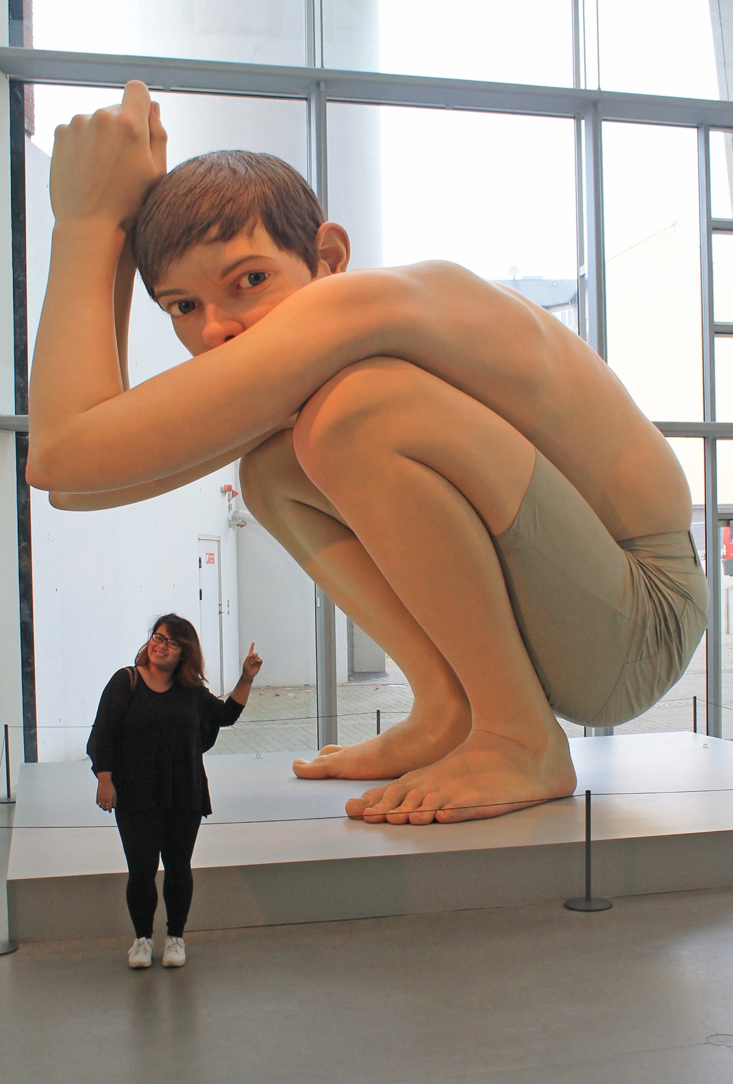 Boy by Ron Mueck Mueck, an Aussie was quoted saying that had he known the boy would go to DK, he would have given him a sweater