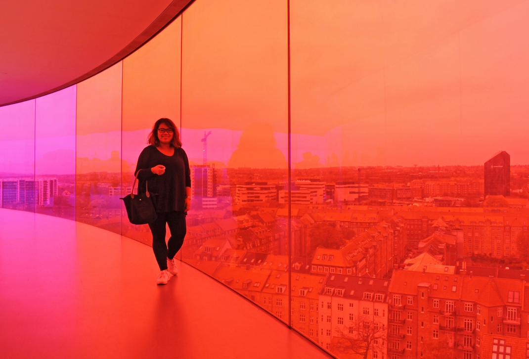 Walking the rainbow walkway while taking in the beautiful view of the city through rainbow- colored glass.